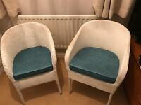 2 Lloyd loom style chairs with seat pads