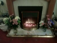 light wood marble fireplace with brass fender , fire not included