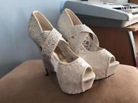 Women's size 7 heels , white side buckle