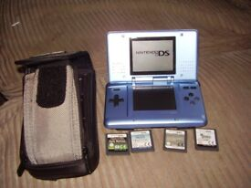 NINTENDO DS WITH GAMES AND CHARGER AND CASE