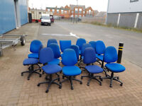 blue office chairs with padded seats and backs