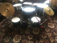 Drum Kit for sale 5 drums, 2 cymbals base pedal stool and drumsticks .