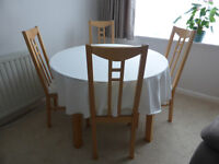 BARGAIN - Glass & Birch Dining Table and matching 4 Birch and Cream Upholstered Dining Chairs