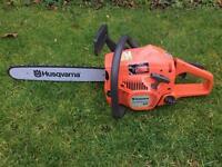 Husqvarna 137 e-series 2 stroke petrol chainsaw chain saw tree cutting logs wood