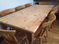 "Strong large solid wood 6ft 6"" long farmhouse dining table with 8 spindle chairs"