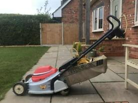 Honda Electric lawnmower with roller