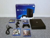 PS4 PRO 1 TB BOXED IMMACULATE CONDITION WITH 4 GAMES