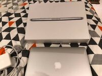 Macbook Pro 13 inch Retina Display Mid 2014 almost new condition with box and all accessories