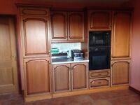 Full solid wood kitchen with integrated fridge, freezer, oven, microwave and dishwasher