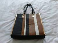 Black and tan tote bag.