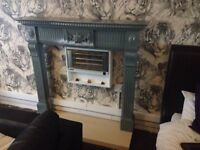 Solid wood fire surround with solid marble base