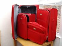 Set of 3 Red suitcases with travel bag. Good condition.