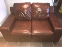 A two and a three seater leather couch £100ono