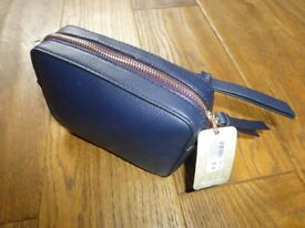Brand new Accessorize navy small handbag with strap