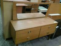 Light brown wooden dressing table with curved mirror