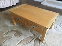 Light oak coffee table. With two draws.