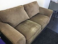Two seater sofa brown for free. self pick up. Slight signs of ware but clean.
