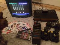 Atari 2600 Woody with 10 games including Space Invaders, Pac-man, Asteroids and Missile Command.