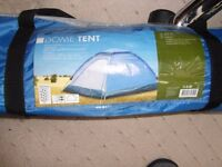 Two person dome tent in carrying bag.