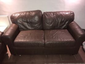 X2 brown leather sofa