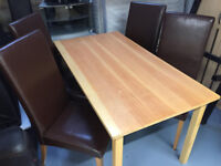 Dining table with 4 brown leather chairs