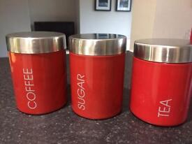 Red and Chrome storage pots