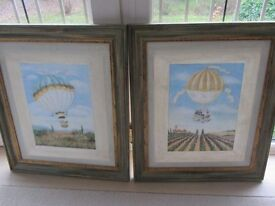 PAIR OF VICTORIAN STYLE BALLOONING CANVAS PRINTS MOUNTED IN GREEN/GOLD WOOD FRAMES