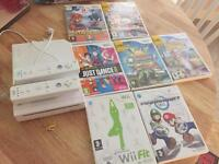 Nintendo wii and games and controllers and num chucks