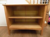 Two shelf wooden effect book case. Mark on left hand side. £15 or nearest offer