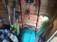 Garden fork, spade, lawnmower and strimmer