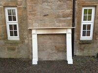 This fire surround is 160cms x 145cms and made of wood.