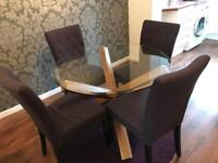 Circular glass table and 4 chairs