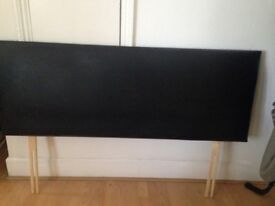 Black leather double bed headboard.