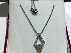 "#1592 18K WHITE GOLD DIAMOND SHAPED PENDANT WITH 16"" LOBSTER CLAW CHAIN. APPRAISED AT $2450.00 SELLING FOR $625.00!"