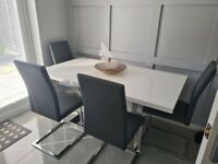 White gloss dining table and chairs