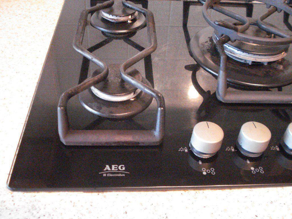 5 Burner AEG gas hob, with wok trivet. Black glass bed ...