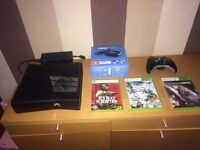 Xbox 360 slim 4GB with pad, games and now TV Boc