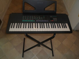 Yamaha electric keyboard with stand and carrycase
