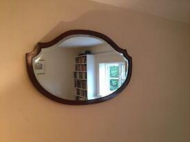 Shaped mahogany framed mirror