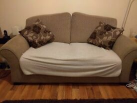 Light brown sofa available with floral brown cushions and cream throw