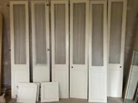 Wardrobe doors x 6 and 4 x matching cupboard doors
