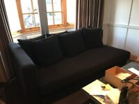 Black chaise lounge sofa, day bed. Excellent condition. Designer Jennifer Post.