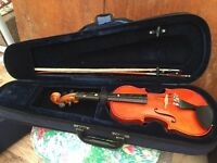 Violin ¼ size with bow and case.