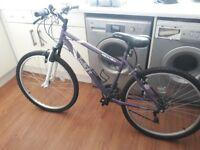 Women's Apollo Twilight mountin bike. Used once. Free helmet with bike.