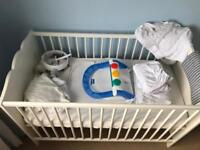 Cot, bedding, mobile and bath seat