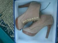 Women's Russel and Bromley heels size 5.