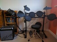 Electronic drum kit, stool and amplifier, excellent condition, buyer collect.