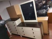 Walnut and cream wood chests of drawers and mirror