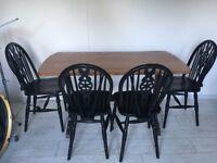 Vintage solid oak wheelback chairs