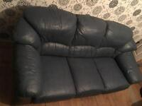 Blue leather sofa and two chairs